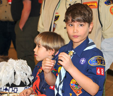 Pack 48 Cubs learn about stitching skins.